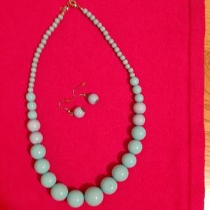 Teal colored beaded necklace with earings.